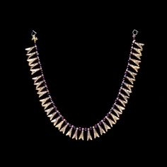 Looooovvveeeee this necklace! Detail: It is Egyptian, over 3000 years old, and kept in the highly secured British Museum. Damn!