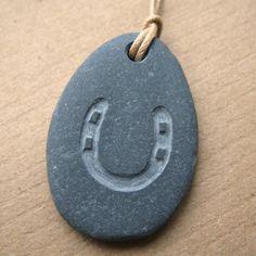 horseshoe pebble necklace.