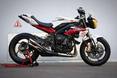 Triumph Street Triple Racebike 2014 | Flickr - Photo Sharing! With Ixil exhaust.