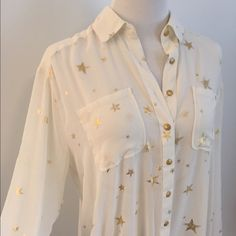 Free People Foil Stars Sheer Shirt White Drawstring waist gold button down with gold foil stars. Sheer. Slit back. Extra Botton included. Free People Tops Blouses