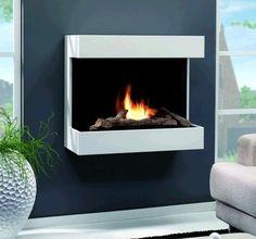 De #RubyFires #Umbria is een moderne #sfeerhaard die is uitgevoerd met een Ruby Fires #keramische brander, die brandt op bio ethanol. Daarnaast is het mogelijk om als decoratie een houtset te gebruiken op uw Ruby Fires Umbria, waardoor een echt houtvuur ontstaat. #Fireplace #Fireplaces #Interieur
