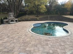 brick pool deck and fireplace