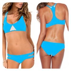 Sexy sporty cut out bikini Sexy sporty bra and cut out bottom bikini, top has racer back, removable padding and is lined on the front, color white details on straps and between bust. Bottoms have cut outs on the sides, lined on the front. Beautiful aqua color. Measurements laying flat Hips 14in Bust 14 inches Swim Bikinis