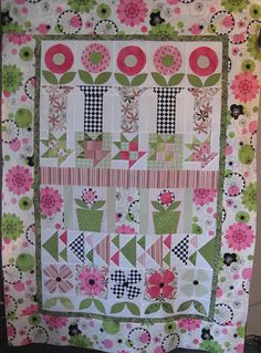 row quilt. I made this flower quilt in reds, yellows, greens, black and white.  It is one of my favorite.
