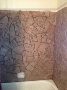 I turned my shower from 70's ceramic into this.  Breaking stone tile with a hammer and covering the ugly ceramic tile for next to nothing.