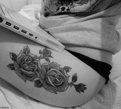 Rose tattoo on top of thigh.