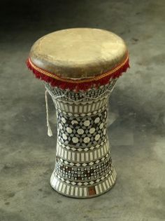 Children can learn about culturally diverse music and musical instruments. For example, they can engage in the Spanish culture musically by trying out these fun bongo drums, an Afro-Cuban percussion instrument.