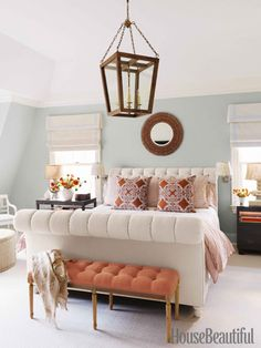 blue/green walls with rich browns, peach/orange and warm wood tone accents - master bedroom
