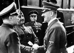 Smiling German ldr. Adolf Hitler (R) shaking hands w. Spanish leader Generalissimo Francisco Franco (2L) during Hitler's only official meeeting w. Franco.  Location:	Hendaye, France