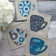This set of 4 mug coasters are made with 4 coordinating floral fabrics with a retro yet modern feel! Each of the coasters have a mug appliqued in cotton fabrics using a free motion machine embroidery technique. The coasters measure approx x Scrap Fabric Projects, Quilting Projects, Sewing Projects, Crafts With Fabric, Sewing Tutorials, Sewing Hacks, Quilted Coasters, Fabric Coasters, Fabric Postcards