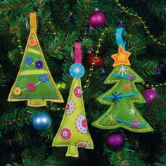 "Our Cheery Tree Ornaments in felt appliqué are perfect for last minute gift-giving. They're a snap to make with die-cut felt that includes pre-punched holes for stitch placement. Contains cotton thread, die-cut polyester felt and acrylic/polyester felt, polyester stuffing, needle, and easy instructions. Finished Size: 3.75"" x 5"" (10 x 12 cm), Set of 3."