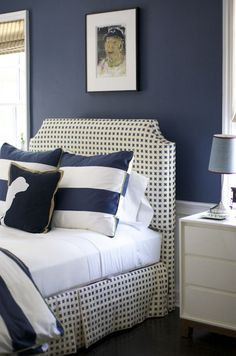 Morrison Fairfax Interiors: Adorable need ideas for boys room now that they are old... room is blue but still too feminine.like the stripes but not the dotted headboard.navy blue big boy's bedroom with navy blue walls paint color paired with crisp ...