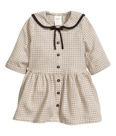 Check this out! BABY EXCLUSIVE. Long-sleeved dress in soft, airy cotton fabric. Tape-trimmed sailor collar and decorative bow at top, buttons at front, seam at waist, and gathered skirt. Unlined. - Visit hm.com to see more.