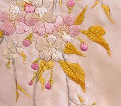 Hand-embroidered Chinese silk coat, The sumptuous coat was made from pale pink silk crepe. It is lined with matching pink silk. The opening, sleeves, side slits, and hem are bordered with hand-embroidered bands of pink satin. Pink Silk, Pink Satin, Pale Pink, Chinese Embroidery, Embroidery Thread, 1920s Clothing, Blue Bells, Beaded Flapper Dress, Chinese Flowers