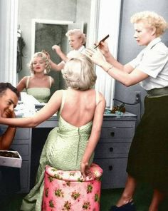 Marilyn Monroe (in color) getting primped and ready for a photo shoot.