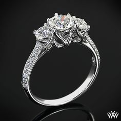 "This gorgeous 3 Stone ""Swan"" Diamond Engagement Ring by Vatche is set in 18k white gold and holds two 0.25ct A CUT ABOVE® Hearts and Arrows Diamond Melee side stones that lead to a 0.755ct A CUT ABOVE® Diamond."