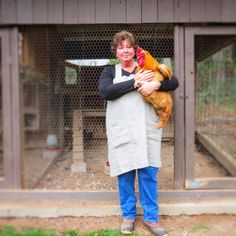 Paula in pinafore with her gorgeous rooster!