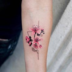 Cherry blossoms on the left inner forearm.