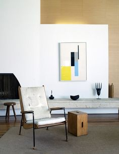 .fireplace, low display bench, abstract art