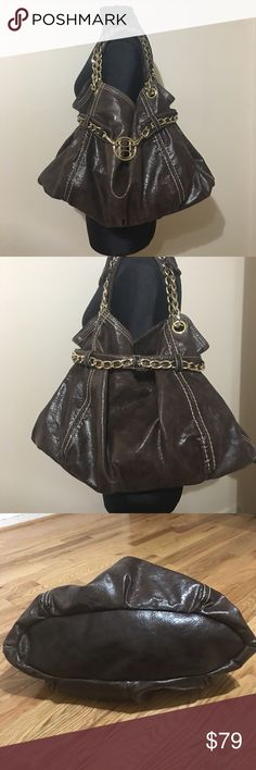 """Bebe bucket bag Brow with gold hardware Bebe bucket bag. Beautiful brow leather with gold chunky chain handles and gold chain around belted top 1/3 of bag. Inside has 1 zippered pocket and 2 slip pockets bottom is structured oval. Bebe logo in center of of """"belt"""" can be removed to enlarge opening of bag 181/2"""" W ( at bottom) and 12"""" t 7"""" double handle drop bebe Bags Hobos"""
