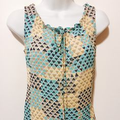 """Banana Republic Navy, Khaki & Teal Printed Top Drawstring neckline, sleeveless blouse. Geometric print featuring Triangle shapes in navy, khaki, teal and yellow all highlighted in white. 100% poly Machine washable 22"""" overall length Banana Republic Tops Blouses"""