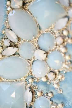 pale blue with white and gold accents