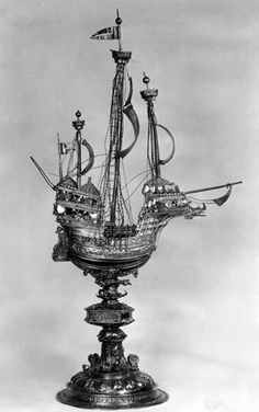 Nef (standing table ornament in the form of a ship) of silver-gilt.  The ship has three masts: the main-mast with crow's-nest, shrouds, stays, and two sails with pennon at the mast-head; the mizen-mast has stays, one sail, made 1530 circa and a crow's-nest, behind it a f