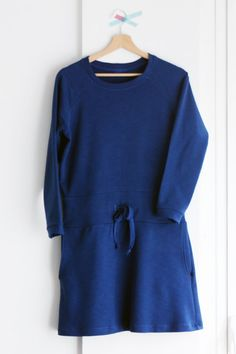 Long sleeve sweatshirt tunic dress made from 100% cotton french terry. It features nice scoop collar, raglan sleeves, a drawstring waist, hidden