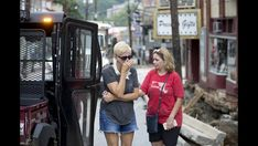 Jen Rynda / Baltimore Sun Media Group Sweet Elizabeth Jane owner Tammy Beideman, right, consoles A Journey from Junk owner Kelli Myers after seeing the flood damage on Main Street in Ellicott City on Monday, August 1, 2016.