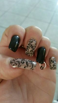 Acrylic nails with gel colour, stamping and a nail ring.
