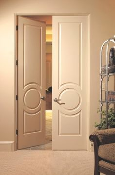 A circular detail distinguishes this three-panel door. Similar designs can be found in French eclectic and Victorian architecture.