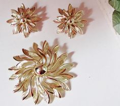 Sarah Coventry Gold Tone Swirl Flower Brooch and by letsreminisce