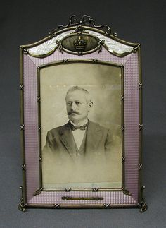 Picture frame by Carl Fabergé, workmaster: Ivan Britsin, 1908–17, in silver-gilt and lavender guilloche enamel