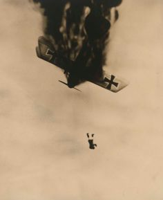 """A pilot jumps from his burning plane. For many pilots the horror of being burned alive in a plane was their greatest fear. Some carried a side arm to finish themselves off. Many simply free-fell to their death.None of the pilots on any of the sides wore parachutes. Parachutes had been invented, but the high commands of the belligerent nations believed that they would destroy the""""fighting spirit"""" of pilots. Of course the high command never flew any planes!"""