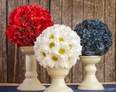 Glue silk flowers to foam balls. You could make these in any color. Would make cute centerpieces.