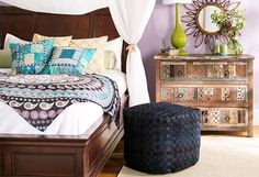 I pinned this for the way the bed is decorated... with a colorful throw/quilt over white bedding.