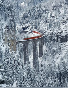 The Landwasser Viaduct is a single track six-arched curved limestone railway viaduct. It spans the Landwasser River between Schmitten and Filisur, in the Canton of Graubünden, Switzerland