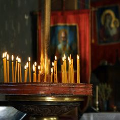 Prayer Candles burning before Orthodox icon...by Tanjica Perovic .