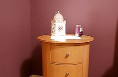 Illuminated Bedside Table  This is a great idea if you have a small bedside table but no room for a lamp.
