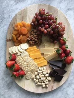 Enjoy this spread as an appetizer or dessert. Nuts and cheese pack in the protein while the fruit and chocolate add just the right amount...