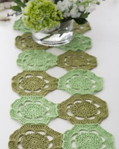 This soft and elegant Sea Grass Table Runner is made using a simple crochet doily pattern.  You can create matching coasters or extend the pattern to make a beautiful afghan or wrap made from doilies.