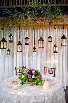 Heavenly hanging lanterns add a beautiful statement to this garden reception. {Rae Marshall Wedding Photography}