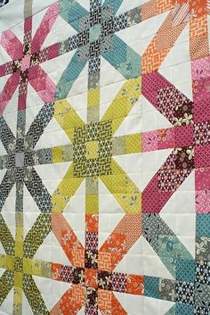 "Freshly Pieced: Supernova Quilt-Along: Fabric Requirements--The finished quilt will measure about 62"" square, and is made up of 9 asterisk-type blocks that I'm calling Supernova blocks. Each of those 9 blocks is made up of smaller sub-units. So we'll be piecing the top in three stages, over three weeks—first the sub-units, then completing the blocks, and then assembling the top and borders"