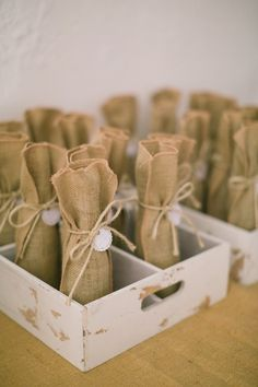 Wine bottles wrapped in sackcloth as wedding favours.   Picture by @enroute    #rusticwedding #countrywedding #favors