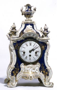 Clock Case, c.1760-65 Soft paste porcelain, coloured enamels, gilt and metal English, Chelsea Unmarked There is a music box mechanism in the rear
