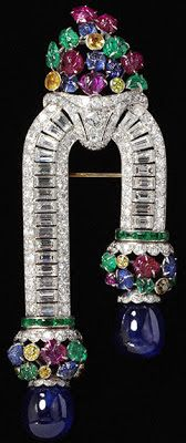 Art Deco Brooch, Possibly Van Cleef & Arpels, Paris, About 1930, Platinum and gold set with baguette- and brilliant-cut yellow diamonds, emeralds, sapphires and rubies, Victoria Albert Museum, London
