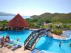 Marea Del Portillo - Manzanillo De Cuba  Situé sur les contreforts de la Sierra Maestra Mountains le Club Amigo Marea del Portillo est excellent pour ceux qui veulent profiter de la mer et des montagnes environnantes. Un favori de longue date des Canadiens!