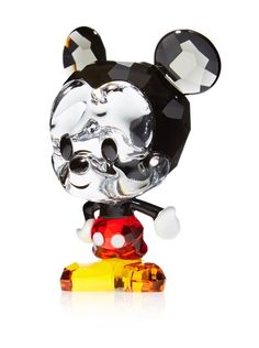 """Swarovski Disney Cuties Mickey Mouse Figurine,  This classic character shimmers in clear crystal with ears in Black Diamond crystal, his hands and arms are made of metal and his trousers are of faceted Light Siam crystal Country of origin: Austria Material type: Crystal, Metal Item Dimensions: length 1.05"""", height 1.8"""", width 1.15""""  http://www.myhabit.com/redirect/ref=qd_sw_dp_pi_li?url=http%3A%2F%2Fwww.myhabit.com%2Fdp%2FB00K5OKZAG"""