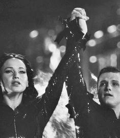 Together. Katniss looks straight and peeta looks to the side