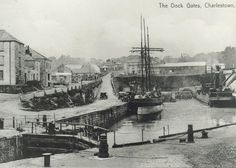 Charlestown as it was and, to some extent, as it still is. The dock gates have been replaced with gates that go down into the water rather than opening. The top end of Charlestown, beyond the trees in the background, has changed with the old foundry yard and buildings turned into a large residential development. Charlestown Cornwall, Great British, Filming Locations, Sailing Ships, Paris Skyline, Britain, Tourism, Coast, Old Things